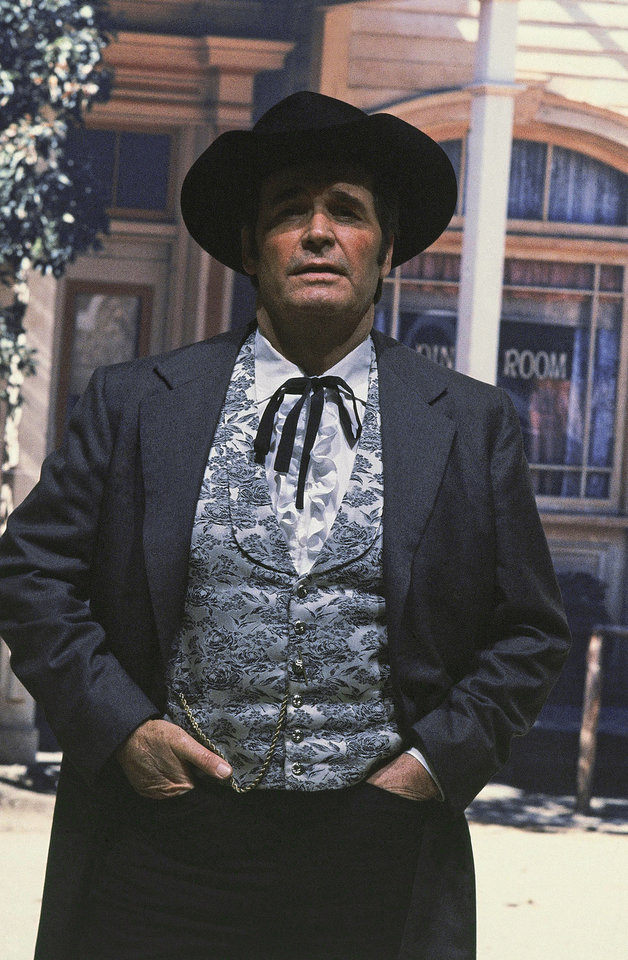 "Photo - FILE - Actor James Garner is shown in character as ""Bret Maverick"" on the set of his television show, in this April 13, 1982 file photo taken in Los Angeles, Calif. Actor James Garner, wisecracking star of TV's ""Maverick"" who went on to a long career on both small and big screen, died Saturday July 19, 2014 according to Los angeles police. He was 86. (AP Photo/Wally Fong, File)"