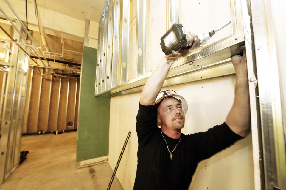 Donnie Pike frames a wall Thursday in the fitness center being created at the state Capitol. Photo By Steve Gooch, The Oklahoman