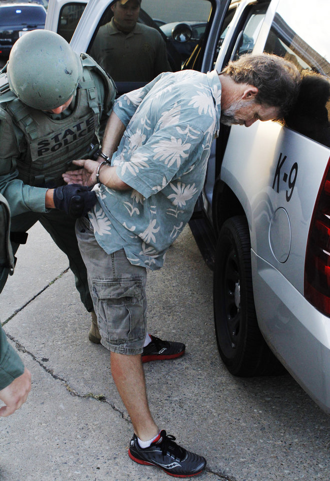 Photo - Oklahoma Bureau of Narcotics and Dangerous Drugs Control agents arrest David Wade McCurley near NW 8 Street and Meridian in Oklahoma City Monday, July 16, 2012, during a raid on individuals connected with a Mexican methamphetamine network in central Oklahoma. OBN agent served 30 arrest warrants at several locations throughout central Oklahoma as part of a year-long joint undercover investigation. Photo by Paul B. Southerland, The Oklahoman ORG XMIT: KOD