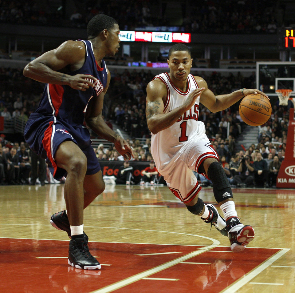 Atlanta Hawks\' Joe Johnson (2) defends a driving Chicago Bulls\' Derrick Rose (1) during the second half of an NBA basketball game Saturday, Dec. 19, 2009, in Chicago. The Bulls defeated the Hawks 101-98 in overtime. (AP Photo/Jim Prisching) ORG XMIT: ILJP109