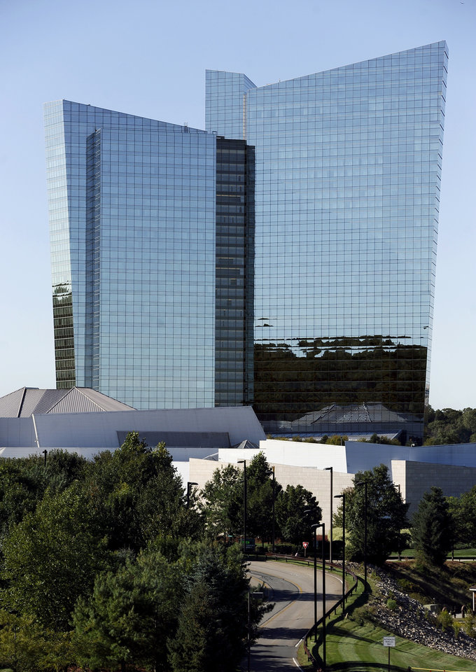 This Sept. 18, 2013, photo shows the Mohegan Sun in Uncasville, Conn. As table games spread across the Northeast, resorts are using their own intelligence network more than ever to stay ahead of suspect players _ professional thieves as well as card counters _ who can easily hit multiple casinos in the span of a few days. (AP Photo/Jessica Hill)