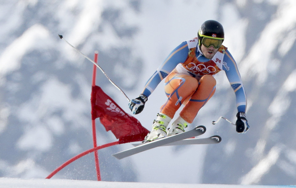 Photo - Norway's Kjetil Jansrud makes a jump to win the gold medal in the men's super-G at the Sochi 2014 Winter Olympics, Sunday, Feb. 16, 2014, in Krasnaya Polyana, Russia.(AP Photo/Charlie Riedel)