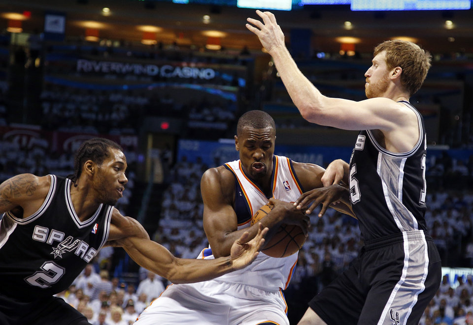 Photo - Oklahoma City's Serge Ibaka (9) looks to get in between San Antonio's Kawhi Leonard (2) and San Antonio's Matt Bonner (15) during Game 6 of the Western Conference Finals in the NBA playoffs between the Oklahoma City Thunder and the San Antonio Spurs at Chesapeake Energy Arena in Oklahoma City, Saturday, May 31, 2014. Photo by Bryan Terry, The Oklahoman
