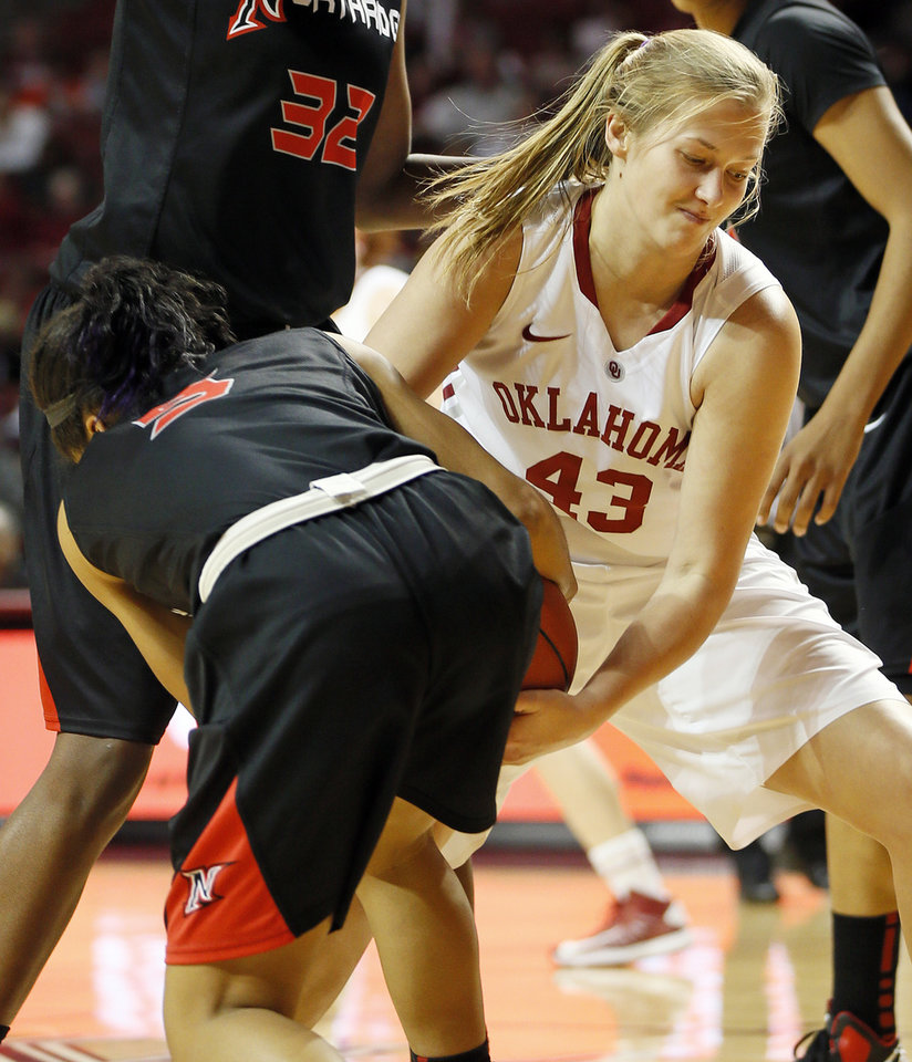 Photo - Oklahoma's Tara Dunn (43) gets tied up with Cal State Northridge's Ashlee Guay (5) in the second half during a women's college basketball game between the University of Oklahoma (OU) and Cal State Northridge at the Lloyd Noble Center in Norman, Okla., Saturday, Dec. 29, 2012. OU won, 79-57.  Photo by Nate Billings, The Oklahoman