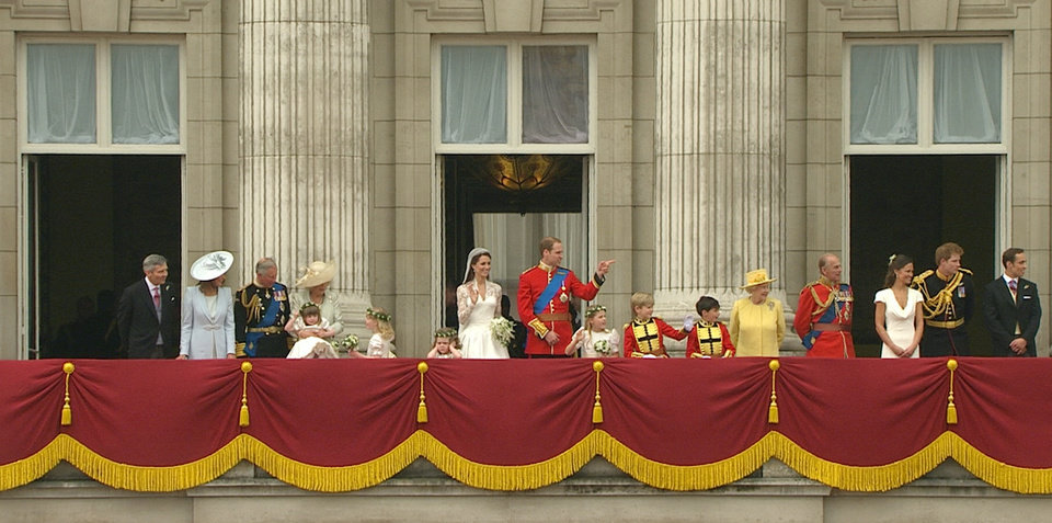 Photo - In this image taken from video, Britain's Prince William, center right, stands on the balcony of Buckingham Palace with his wife, Kate, the Dutchess of Cambridge, center left, and other royals after the Royal Wedding in London on Friday, April, 29, 2011. (AP Photo/APTN) EDITORIAL USE ONLY NO ARCHIVE PHOTO TO BE USED SOLELY TO ILLUSTRATE NEWS REPORTING OR COMMENTARY ON THE FACTS OR EVENTS DEPICTED IN THIS IMAGE ORG XMIT: RWVM313