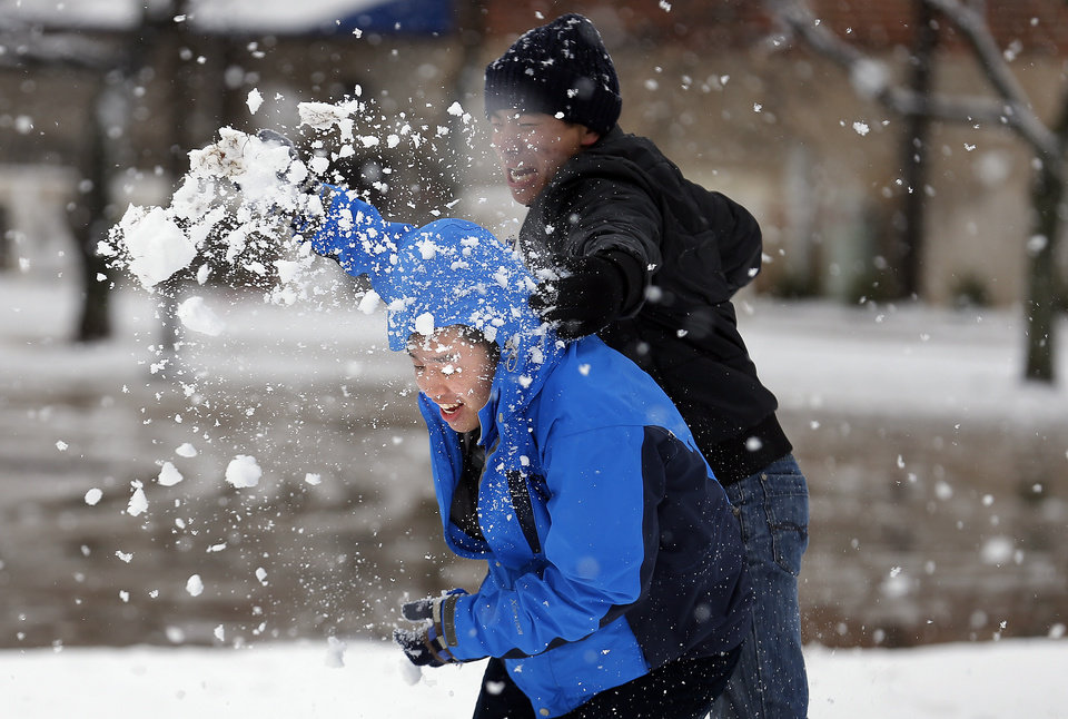 Photo - Chris Xiao throws snowball at Will Tang, left, at the University of Central Oklahoma in Edmond, Okla., Wednesday, Feb. 13, 2013.Photo by Sarah Phipps, The Oklahoman