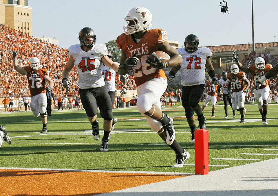 Photo - Texas' Malcolm Brown (28) scores a touchdown in front of Oklahoma State's Caleb Lavey (45) and Christian Littlehead (72) in the third quarter during a college football game between the Oklahoma State University Cowboys (OSU) and the University of Texas Longhorns (UT) at Darrell K Royal-Texas Memorial Stadium in Austin, Texas, Saturday, Oct. 15, 2011. OSU won, 38-26. Photo by Nate Billings, The Oklahoman