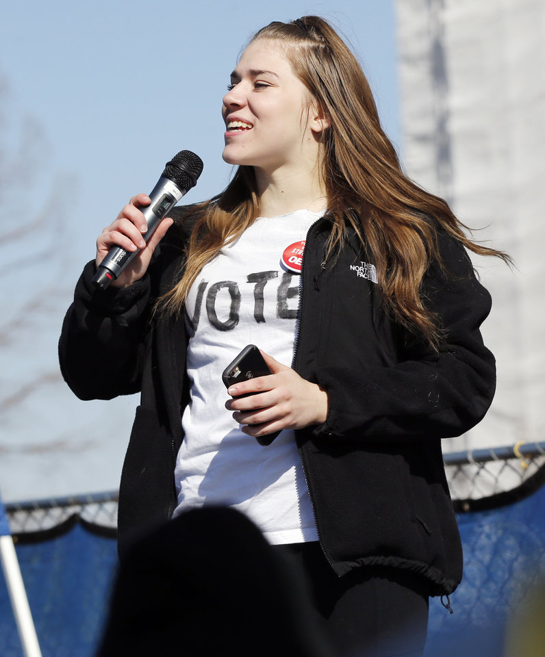 Photo - Midwest City senior Nataly Hurt speaks during a rally by students in support of teachers on the third day of a walkout by Oklahoma teachers at the state Capitol in Oklahoma City, Wednesday, April 4, 2018. Photo by Nate Billings, The Oklahoman
