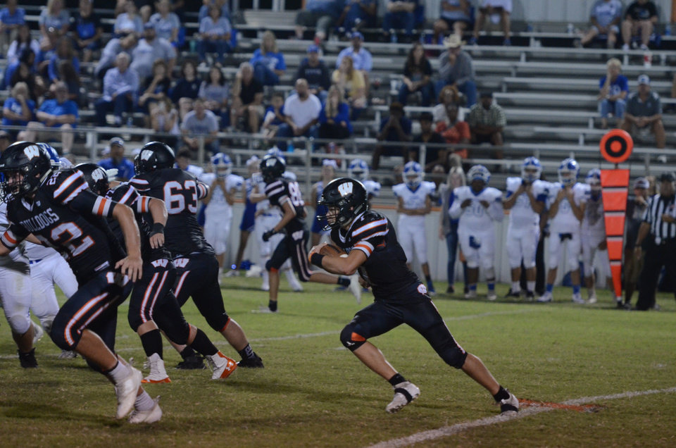 Photo -  Ethan Mullins led Wayne to its first win of the season Friday. [Photo courtesy of The Purcell Register]