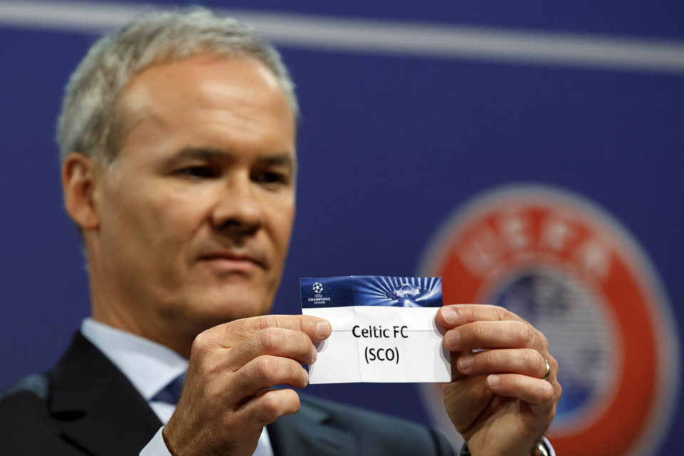 Photo - Giorgio Marchetti, UEFA Director of professional football, shows the ticket of Scottish club Celtic FC, during the draw of the games for the Champions League 2014/15 playoff rounds, at the UEFA headquarters in Nyon, Switzerland, Friday, Aug. 8, 2014. (AP Photo/Keystone, Salvatore Di Nolfi)