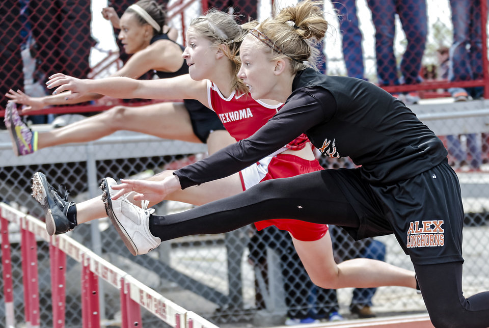 Texhoma's Randi Yates and Alex's Holly Anderson go head to head in the Class A 100m hurdles during the Class A and 2A state championship track meet at Carl Albert High School on Friday, May 3, 2013, in Midwest City, Okla. Photo by Chris Landsberger, The Oklahoman