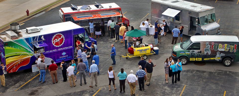 Mobile food trucks gather in Oklahoma City in this 2010 file photo. The concept of mobile food vending dates to chuck wagons that rolled in the wake of cattle drives across the country�s prairies. PHOTO BY CHRIS LANDSBERGER, THE OKLAHOMAN ARCHIVEs