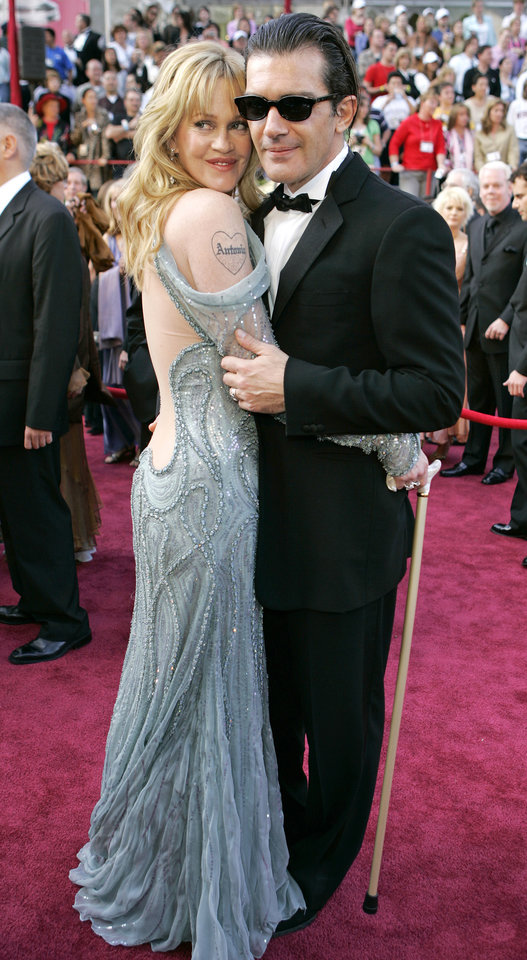 Photo - FILE - This Feb. 27, 2005 file photo shows actor Antonio Banderas with his wife Melanie Griffith, left, at the 77th Academy Awards in Los Angeles. Griffith is sporting a tattoo with Antonio's name. Griffith filed for divorce from Banderas on Friday June 6, 2014 in Los Angeles, citing irreconcilable differences as the reason for the end of their 18-year marriage. (AP Photo/Laura Rauch, File)
