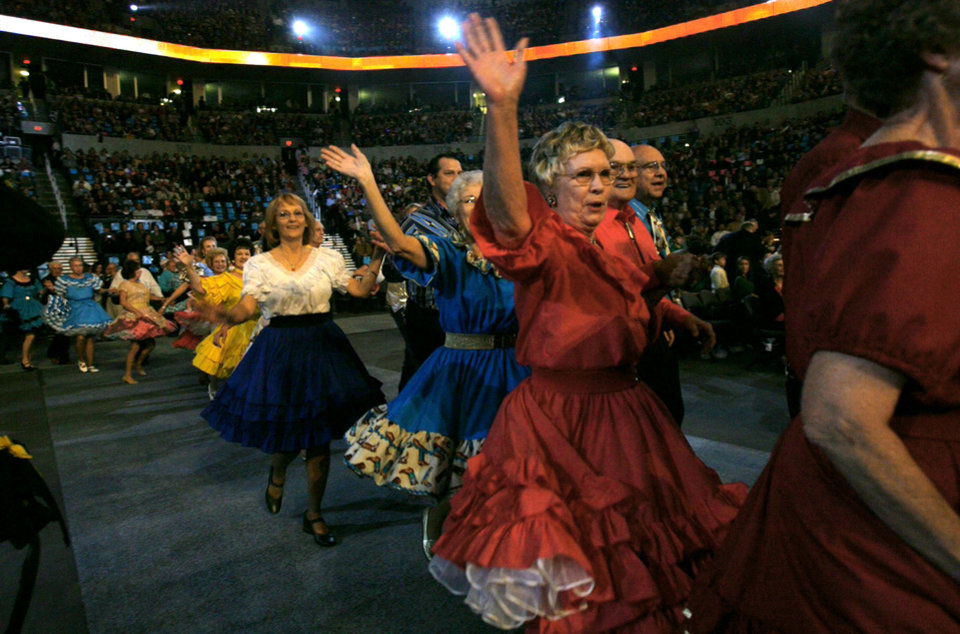 Photo - Squaredancers perform during the Centennial Spectacular to celebrate the 100th birthday of the State of Oklahoma at the Ford Center on Friday, Nov. 16, 2007, in Oklahoma City, Okla. STAFF PHOTO BY CHRIS LANDSBERGER/THE OKLAHOMAN