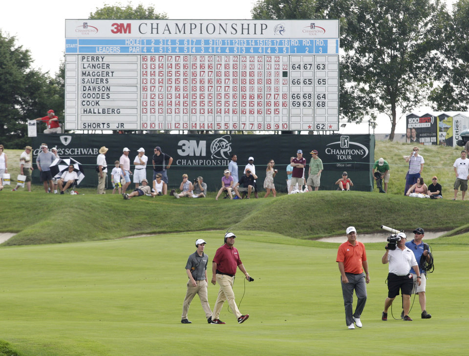 Photo - Kenny Perry, third right, walks up to the 18th green during the third round of the Champions Tour 3M Championship golf tournament at TPC Twin Cities in Blaine, Minn., Sunday, Aug. 3, 2014. Perry won the tournament. AP Photo/Paul Battaglia)