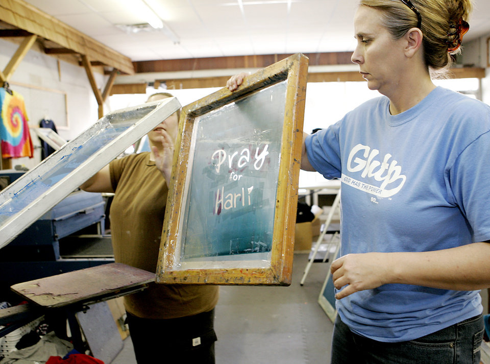 Photo - MINI-SPRINT CAR RACING, RACER: Harli White's aunt Koye Baade (CQ) KOYE BAADE and employee Errin O'Quinn (ERRIN O'QUINN) work on a t-shirt for Harli at their sceen printing shop called 1Way Print and Stitch in Purcell on Monday, April 7, 2008. Harli was burned in a racing accident on Saturday. Her family in Purcell is printing t-shirts to raise money for her. By John Clanton, The Oklahoman ORG XMIT: KOD