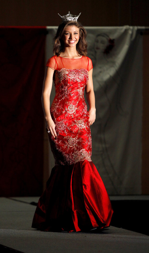 Miss Oklahoma Betty Thompson wearing a Stella Thomas design walks the runway during the OSU chapter of the American Association of University Women's fundraiser, An Evening of Arts and Fashion, on the campus of Oklahoma State University in Stillwater, Okla., Friday, March 16, 2012. Photo by Bryan Terry, The Oklahoman