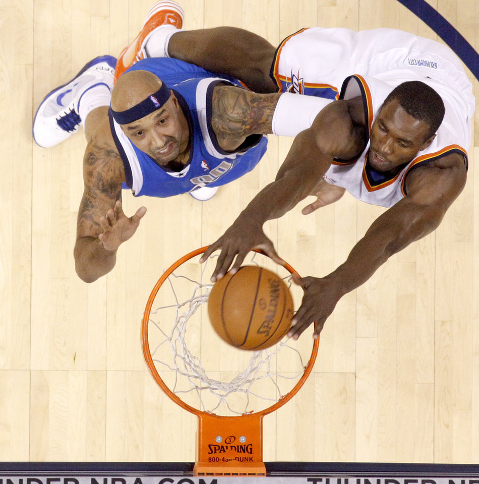 Photo - Oklahoma City's Serge Ibaka dunks the ball in front of Drew Gooden of Dallas during the NBA basketball game between the Oklahoma City Thunder and the Dallas Mavericks at the Ford Center in Oklahoma City on Wednesday, December 16, 2009. Photo by Bryan Terry, The Oklahoman