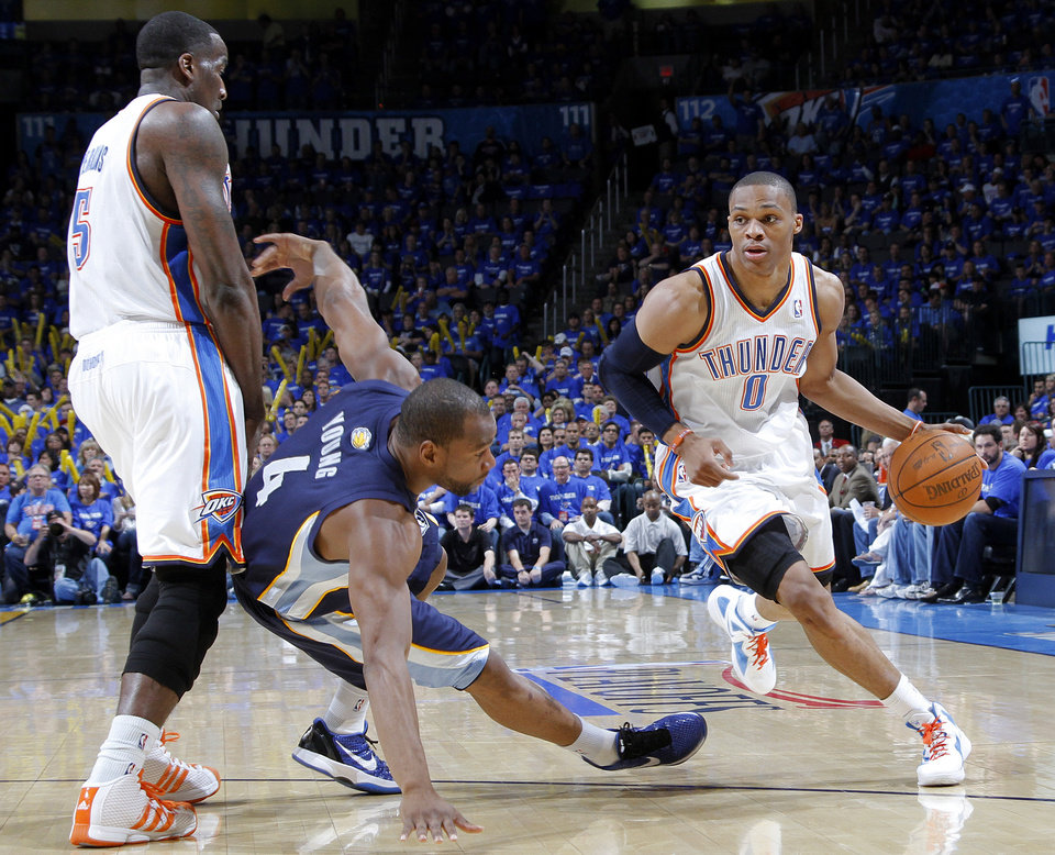 Photo - Oklahoma City's Russell Westbrook (0) drives past the Oklahoma City's Kendrick Perkins (5) pick on Sam Young (4) of Memphis during game two of the Western Conference semifinals between the Memphis Grizzlies and the Oklahoma City Thunder in the NBA basketball playoffs at Oklahoma City Arena in Oklahoma City, Tuesday, May 3, 2011. Photo by Chris Landsberger, The Oklahoman