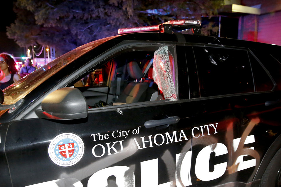 Photo - A damaged Oklahoma City police vehicle is seen during a protest outside the Oklahoma City Police Department in Oklahoma City, Saturday, May 30, 2020. The protest was in response to the death of George Floyd. [Bryan Terry/The Oklahoman]