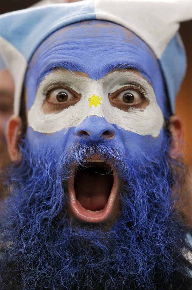 Photo - An Argentine supporter yells during the group F World Cup soccer match between Argentina and Bosnia at the Maracana Stadium in Rio de Janeiro, Brazil, Sunday, June 15, 2014. (AP Photo/Thanassis Stavrakis)