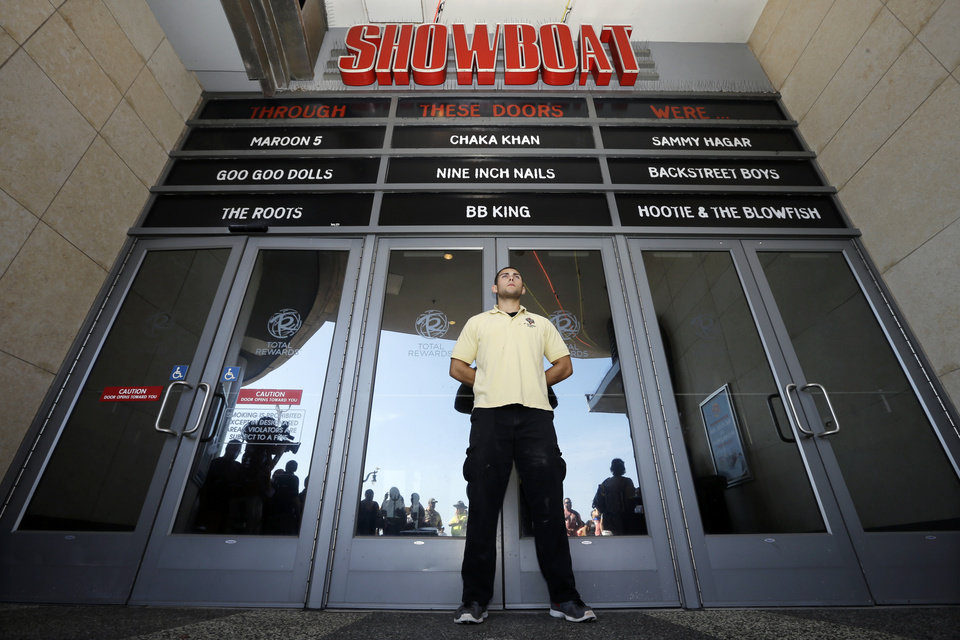 Photo - A security guard blocks entrance to the closing Showboat Casino Hotel Sunday, Aug. 31, 2014, in Atlantic City, N.J. The show is ending for the Showboat Casino Hotel in Atlantic City. The Mardi Gras-themed casino is shutting down at 4 p.m. Sunday after 27 years on the Boardwalk. Owner Caesars Entertainment is closing the still-profitable Showboat to reduce the number of casinos in Atlantic City, which has been struggling with plunging revenue and increased competition. (AP Photo/Mel Evans)