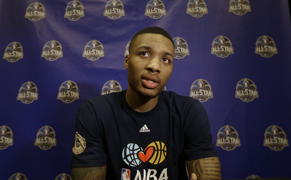 Photo - Portland Trail Blazers  player Damian Lillard  speaks during the NBA All Star basketball news conference, Friday, Feb. 14, 2014, in New Orleans. The 63rd annual NBA All Star game will be played Sunday in New Orleans. (AP Photo/Gerald Herbert)