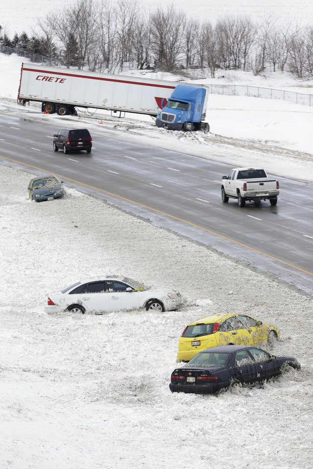 Vehicles line the ditch of Interstate 80 in Lincoln, Neb., Monday, March 11, 2013, after a winter storm dumped several inches of snow and strong winds created hazardous conditions. (AP Photo/Nati Harnik)