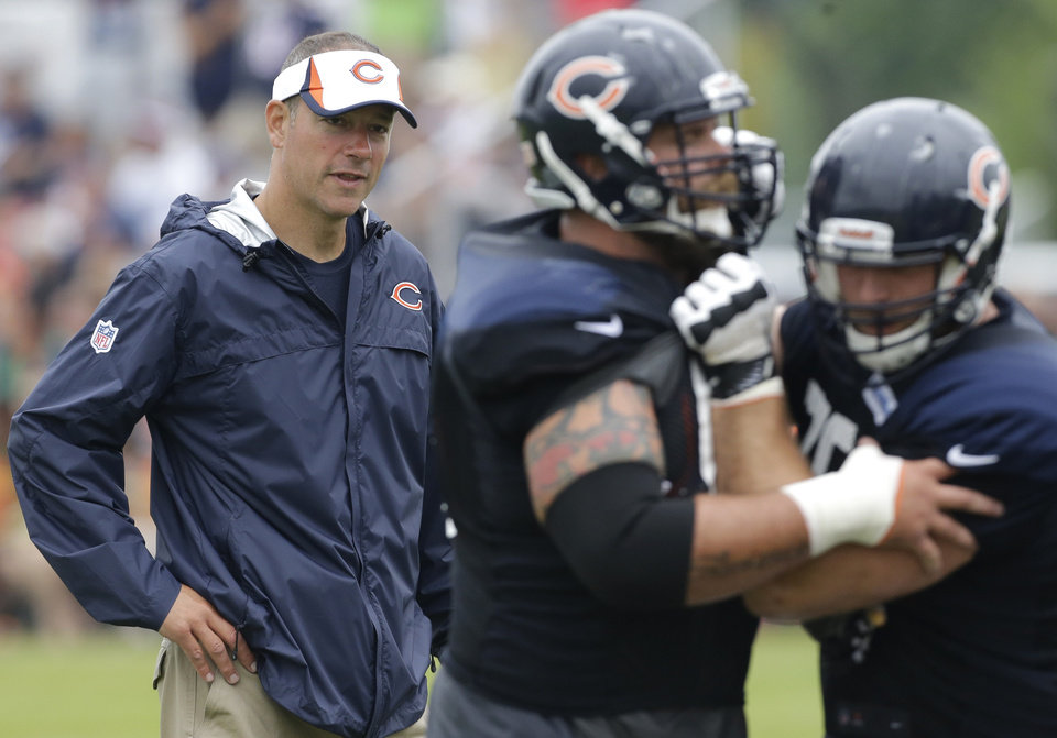 Photo - Chicago Bears Chicago Bears offensive coordinator Aaron Kromer, left, watches his team during NFL football training camp Wednesday, July 31, 2013, in Bourbonnais, Ill. (AP Photo/Nam Y. Huh)