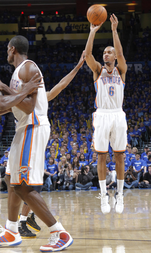Oklahoma City's Eric Maynor (6) puts up a three point shot during game two of the Western Conference semifinals between the Memphis Grizzlies and the Oklahoma City Thunder in the NBA basketball playoffs at Oklahoma City Arena in Oklahoma City, Tuesday, May 3, 2011. Photo by Chris Landsberger, The Oklahoman