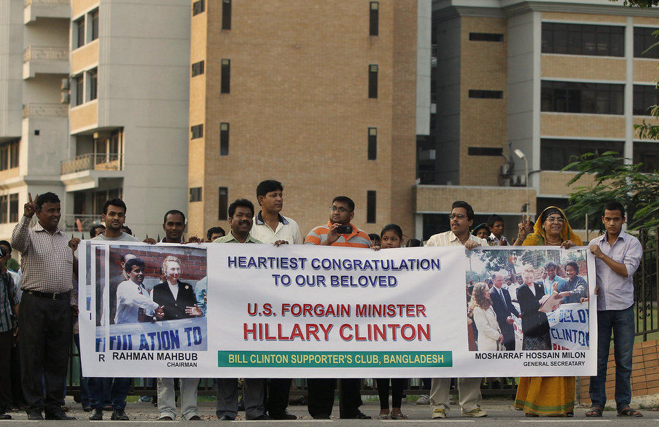 Photo -   Supporters of U.S. Secretary of State Hillary Clinton line the streets as her motorcade makes its way through the streets of Dhaka, Bangladesh Saturday May 5, 2012. (AP Photo/Shannon Stapleton, Pool)