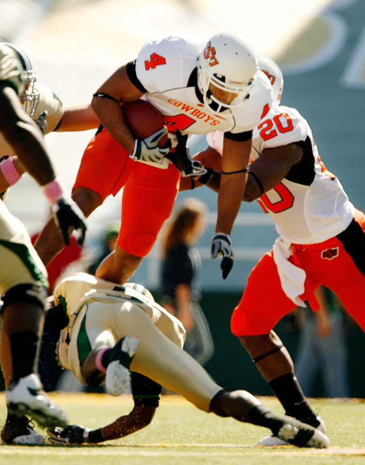 Photo - Patrick Lavine (4) carries after an interception during the college football game between Baylor University and Oklahoma State University (OSU) at Floyd Casey Stadium in Waco, Texas, on Saturday, Oct. 24, 2009.  Photo by Steve Sisney, The Oklahoman