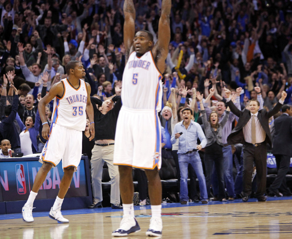 Kendrick Perkins (5) celebrates along with fans and head coach Scott Brooks, right, after Kevin Durant (35), left, hit the game-winning shot as time expired in an NBA basketball game between the Oklahoma City Thunder and the Dallas Mavericks at Chesapeake Energy Arena in Oklahoma City, Thursday, Dec. 29, 2011. Oklahoma City won, 104-102. Photo by Nate Billings, The Oklahoman
