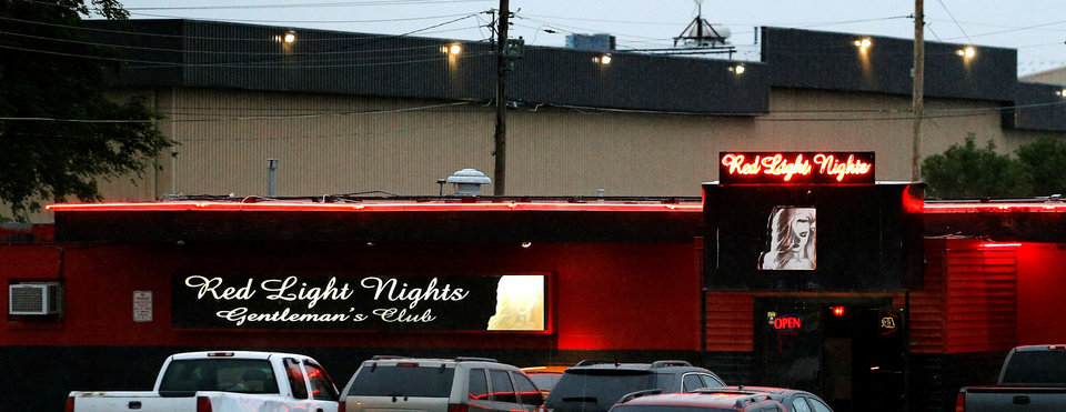 Photo -  The operator of Red Light Nights is seeking a variance from Oklahoma City zoning regulations so it can continue to operate.  PHOTO BY BRYAN TERRY, THE OKLAHOMAN ARCHIVES