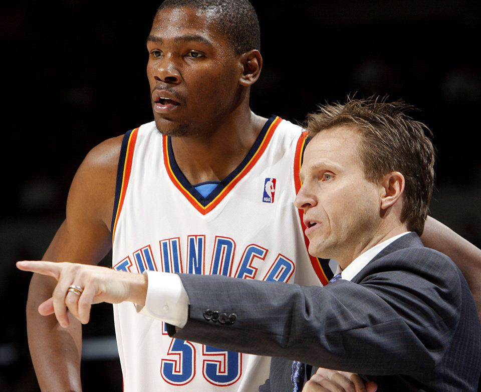 Photo - Oklahoma City's Kevin Durant talks with head coach Scott Brooks during their game against the New York Knicks  at the Ford Center in downtown  Oklahoma City on Tuesday, Jan. 6, 2009. By John Clanton, The Oklahoman