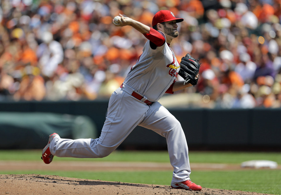 Photo - St. Louis Cardinals starting pitcher Lance Lynn throws to the Baltimore Orioles in the first inning of an interleague baseball game, Sunday, Aug. 10, 2014, in Baltimore. (AP Photo/Patrick Semansky)
