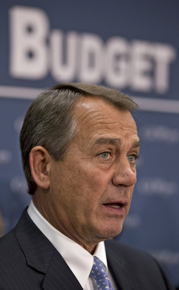 House Speaker John Boehner of Ohio talks to reporters on Capitol Hill in Washington, Tuesday, Feb. 5, 2013, following a political strategy meeting. President Barack Obama will ask Congress to come up with tens of billions of dollars in short-term spending cuts and tax revenue to put off the automatic across the board cuts that are scheduled to kick in March 1.    (AP Photo/J. Scott Applewhite)