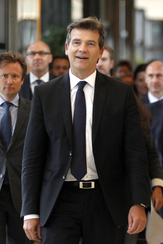 Photo - Economy Minister Arnaud Montebourg arrives for a press conference in Paris, Monday, Aug.25, 2014. France's Socialist government dissolved on Monday after open feuding in the Cabinet over how much cutting _ or spending _ will revive the country's stagnant economy. The country is under pressure from the 28-nation European Union to get its finances in order, but Economy Minister Arnaud Montebourg has questioned whether austerity will really kick start French growth.  (AP Photo/Christophe Ena)