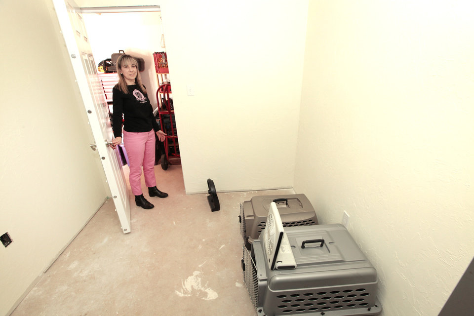 Photo - Rita Chandler looks in her shelter installed by Oklahoma Storm Rooms at her home in northwest Oklahoma City.  Photo by David McDaniel, The Oklahoman  David McDaniel -