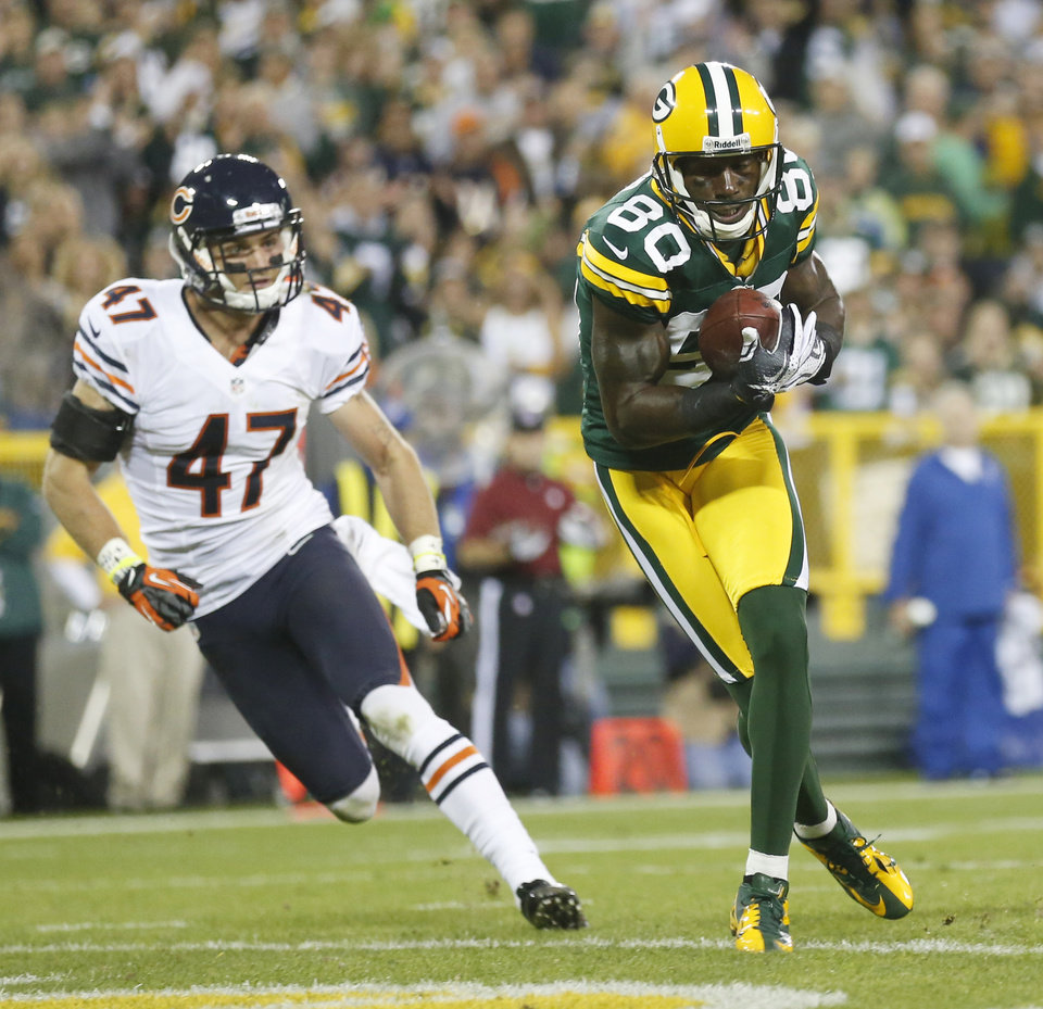 Photo -   Green Bay Packers' Donald Driver catches a touchdown pass in front of Chicago Bears' Chris Conte (47) during the second half of an NFL football game Thursday, Sept. 13, 2012, in Green Bay, Wis. (AP Photo/Jeffrey Phelps)