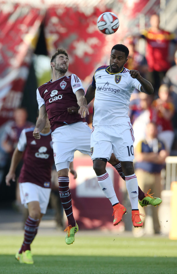 Photo - Colorado Rapids midfielder Jose Mari, left, and Real Salt Lake forward Robbie Findley go up for a head ball in the first half of a Major League Soccer game in Commerce City, Colo., on Saturday, Aug. 2, 2014. (AP Photo/David Zalubowski)