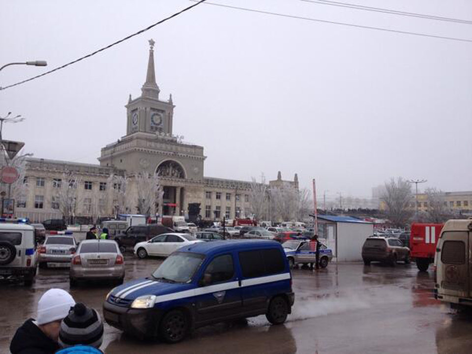 Photo - In this photo taken on a cell phone,  made available by Volgograd Mayor's Office, emergency services approach a square outside a main entrance of the Volgograd railway station, Sunday, Dec. 29, 2013. More then a dozen people were killed and scores were wounded Sunday by a suicide bomber at a railway station in southern Russia, officials said, heightening concern about terrorism ahead of February's Olympics in the Black Sea resort of Sochi. (AP Photo/Nikita Baryshev,Volgograd Mayor's Office Handout)
