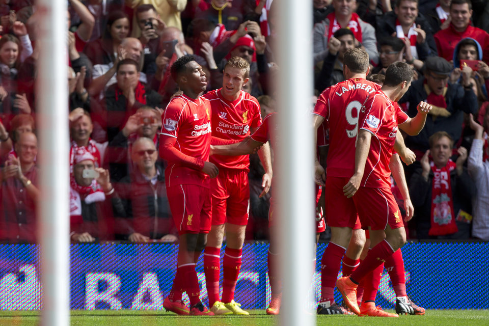 Photo - Liverpool's Daniel Sturridge, left, celebrates with teammates after scoring against Southampton during their English Premier League soccer match at Anfield Stadium, Liverpool, England, Sunday Aug. 17, 2014. (AP Photo/Jon Super)