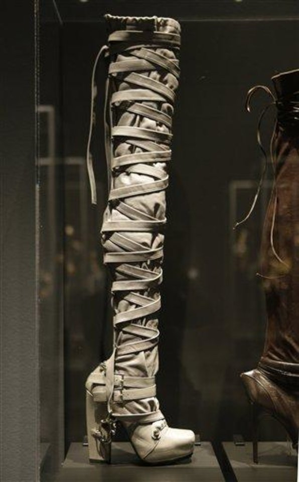 "This Feb. 11, 2013 photo shows a thigh-high boot designed by Nicholas Kirkwood for the Rodarte spring 2009 fashion show at the ""Shoe Obsession"" exhibit at The Museum at the Fashion Institute of Technology Museum in New York. The exhibition, showing off 153 specimens, runs through April 13. (AP Photo/Kathy Willens)"