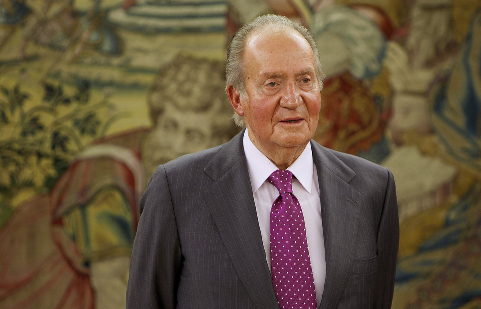 Photo - FILE - In this file photo from March 6, 2014 Spain's King Juan Carlos attends the 9th edition of the FONDENA award at the Zarzuela Palace in Madrid, Spain, Spanish Prime Minister Mariano Rajoy says King Juan Carlos plans to abdicate and pave the way for his son, Crown Prince Felipe, to become the country's next king. The 76-year-old Juan Carlos oversaw his country's transition from dictatorship to democracy but has had repeated health problems in recent years. His popularity also dipped following royal scandals, including an elephant-shooting trip he took in the middle of Spain's financial crisis that tarnished the monarch's image. The king came to power in 1975, two days after the death of longtime dictator Francisco Franco.  (AP Photo/Abraham Caro Marin, File)