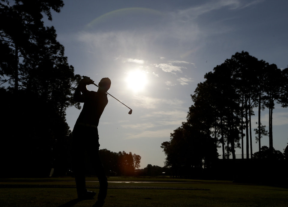 Photo - Martin Kaymer, of Germany, watches his tee shot on the third hole during a practice round for the U.S. Open golf tournament in Pinehurst, N.C., Wednesday, June 11, 2014. The tournament starts Thursday. (AP Photo/Chuck Burton)