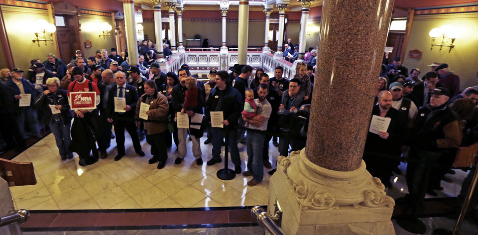 Photo - Gun rights advocates fill the hallways of the Capitol in Hartford, Conn., Wednesday, April 3, 2013. Hundreds of gun rights advocates are gathering at the statehouse in Hartford ahead of a vote in the General Assembly on proposed gun-control legislation. (AP Photo/Charles Krupa)