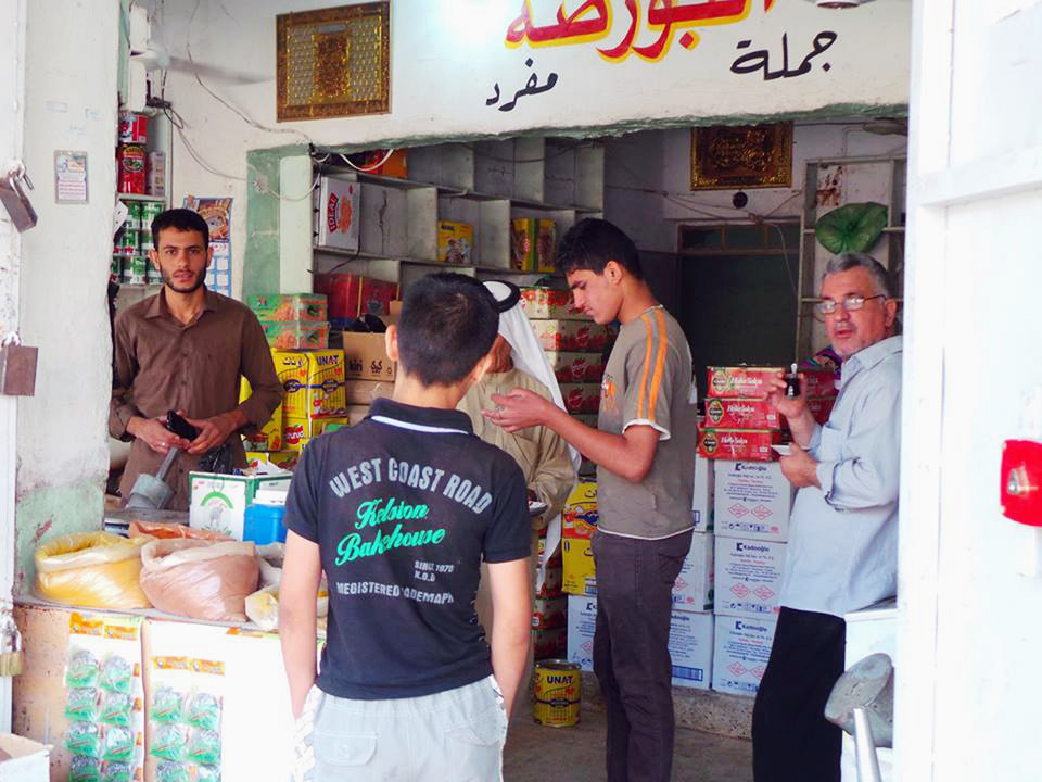 Photo - People shop for food and other supplies in the northern city of Mosul, Iraq, Friday, June 13, 2014. Iraqi officials say al-Qaida-inspired militants who this week seized much of the country's Sunni heartland have pushed into an ethnically mixed province northeast of Baghdad, capturing two towns there.(AP Photo)
