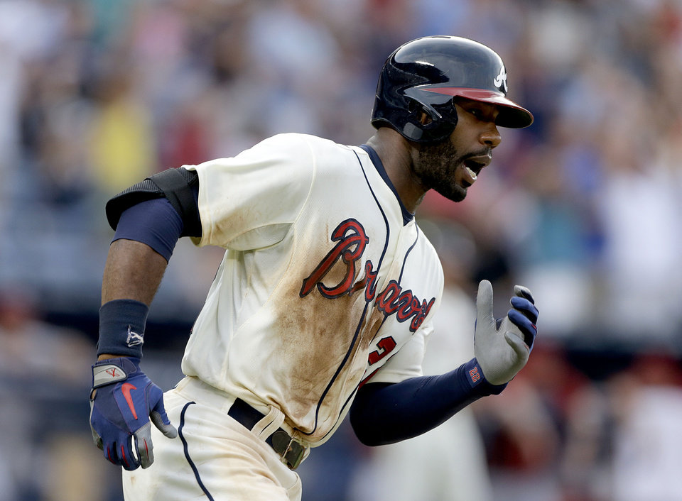 Photo - Atlanta Braves' Jason Heyward rounds the bases after hitting a double to score teammates Andrelton Simmons and Reed Johnson, not pictured, in the eighth inning of a baseball game against the Arizona Diamondbacks, Saturday, June 29, 2013, in Atlanta. (AP Photo/David Goldman)