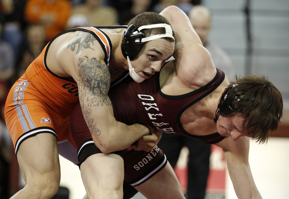 OU's Nick Lester wrestles OSU's Jordan Oliver during the wrestling match between Oklahoma University and Oklahoma State University at McCasland Field House in Norman, Okla.,Sunday, Dec. 9, 2012.  Photo by Garett Fisbeck, For The Oklahoman
